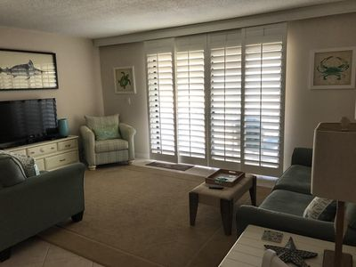 Living room area opening to balcony..