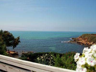 Photo for Charming apartment, 10 metres from the sea with a gorgeous terrace