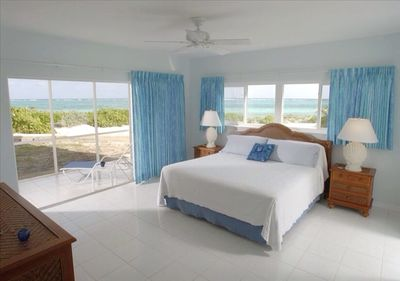 Panoramic ocean views in this spacious master! Steps out to porch & beach!