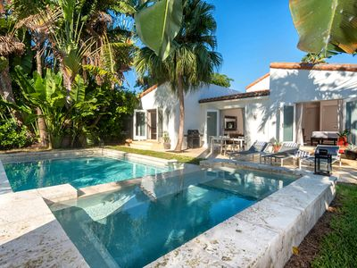 Private backyard with heated, salt water pool & jacuzzi. Chaise lounges & dining
