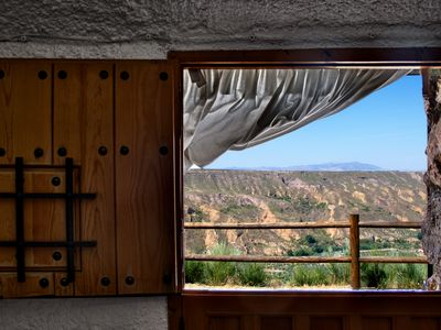 Photo for Traditional cave with views of the Sierra Nevada.