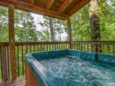 Photo for Unique mountain view cabin w/ private hot tub, deck & air hockey