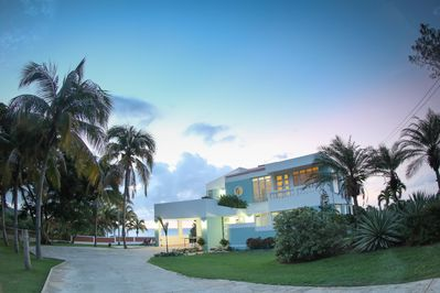 Four bedrooms, three baths on over one acre private fenced ocean front yard