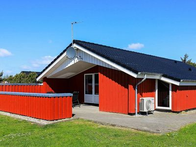 Photo for Warm Holiday Home in Vejers Strand Denmark with Spa