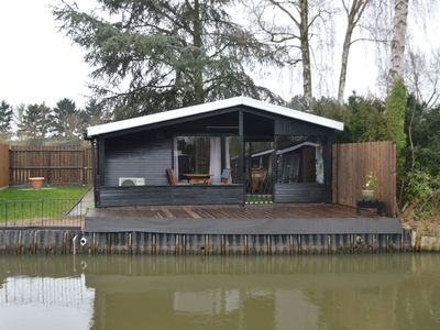 Photo for Modern chalet in a small park, located right along a fishing pond