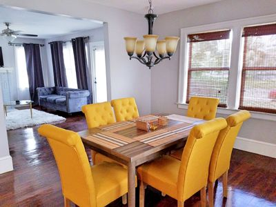 Large dining room with table setting for 6 people