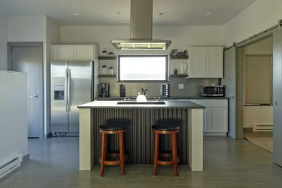 Open kitchen with all the necessities for a cup of coffee or cooking up a meal.