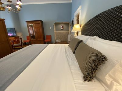 Sleep soundly between soft linens on the Ullrich Suite's King-sized bed.