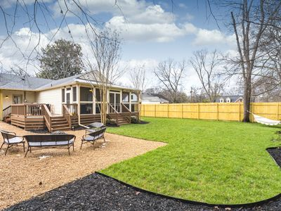 Photo for Backyard Oasis 4 Miles to Downtown! Hot Tub, Fire Pit, Games!