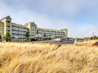 Photo for Dog-friendly condo w/ balcony, ocean view - steps from the beach and town!