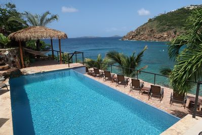 Listen to the gentle waves while swimming and sunning in loungers and hammocks.