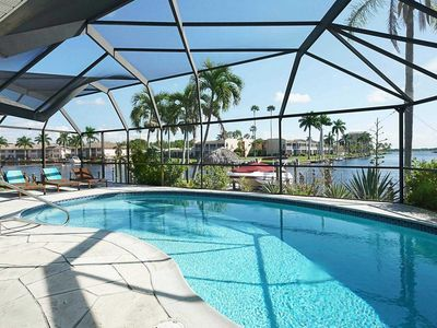 Photo for SWFL Rentals - Villa Aqua Marina - Gulf Access Heated Pool Home Sleeps 6