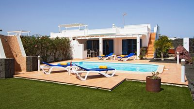 Photo for Two bedroom villa, private heated pool,hot tub and private large garden