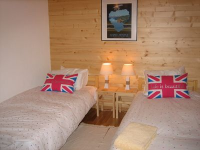Bedroom 2 - two twin beds & third child's bed (or travel cot). Access to terrace