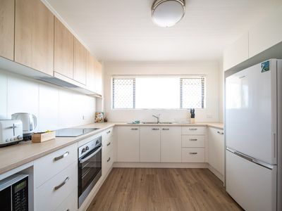Photo for Walking to beach - Newly renovated 2 bedroom unit with A/C &  lockup garage