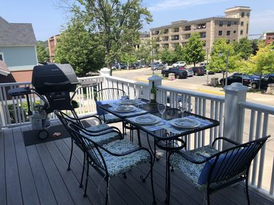 Outdoor deck with gas grill and view over downtown