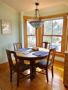 Eat-in kitchen with oak table and chairs, stained glass chandelier