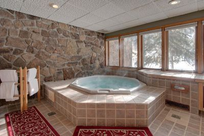 Windows and patio door open for cold air while using the private hot tub.