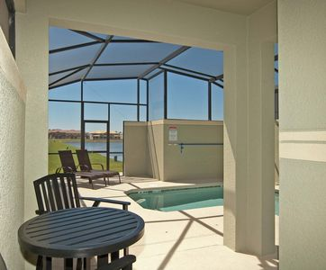 Photo for SOUTH FACING POOL, LAKE VIEW, 2 MASTER SUITES, ONLY 7 MILES FROM DISNEY IN PARADISE PALMS RESORT COMMUNITY!!
