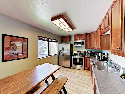 Kitchen - The modern kitchen features wood cabinets and a full suite of brand-new stainless steel appliances.