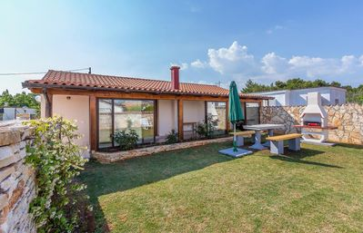 Photo for Holiday home for sole use in Medulin with 2 bedrooms, washing machine, air conditioning, wifi, terrace and barbecue area