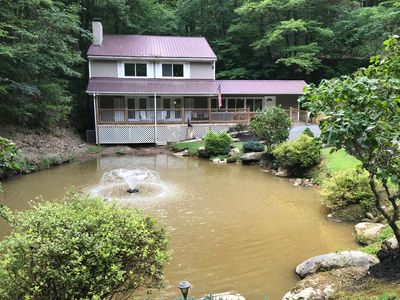 Seclusion, privacy, private fish pond, located on 4 acres in a gated community!