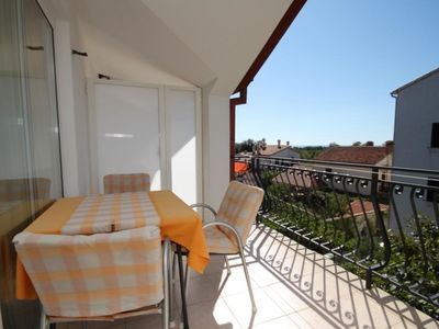 Photo for One bedroom apartment with terrace and sea view Rovinj (A-7195-a)