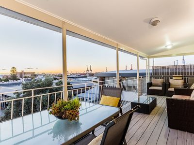 Photo for One bedroom boutique penthouse apartment with 180 degree city and ocean views.