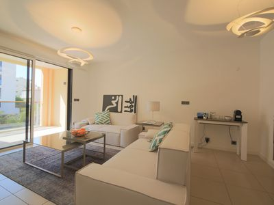Photo for Contemporary apartment located in a residence with pool near Palm Beach.