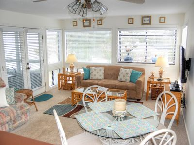 Photo for Just steps to the beach, this condo is located next to Harry the Hats and across from the Apache ...