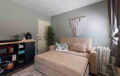 Photo for Petite studio suite with relaxing park-like backyard