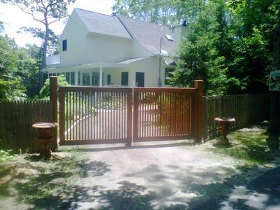 Completely fenced in property with electric gates with remote