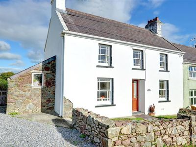 Photo for This very old and charming semi-detached cottage is located in the peaceful hamlet of Llangwm Ferry