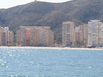 Photo for Cullera beach front sea, feet in the water.