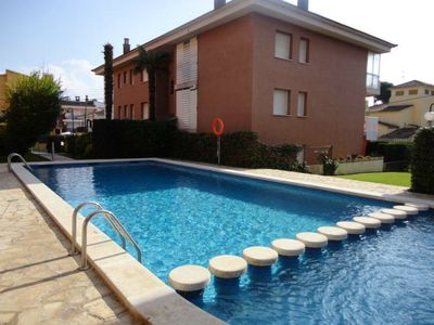 Photo for Modern with large communal pool and ACC only 400 meters from the beach and center!