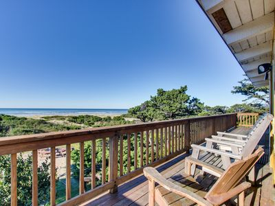 Photo for Ground-level beachside cottage with shared hot tubs and dog-friendly attitude!