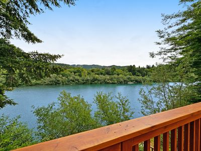 Photo for NEW LISTING! Lovely riverfront home w/ wraparound deck, fireplace & river access