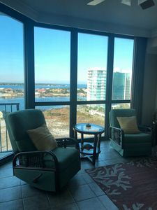 Floor to ceiling windows and bay views