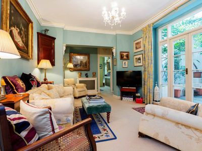 Photo for Palatial, sun-filled apt. with lovely garden patio in South Kensington (Veeve)