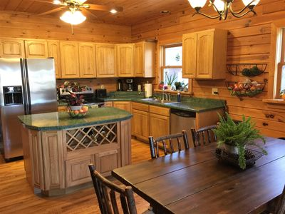 A large welcoming kitchen with plenty of counter space for food preparation.