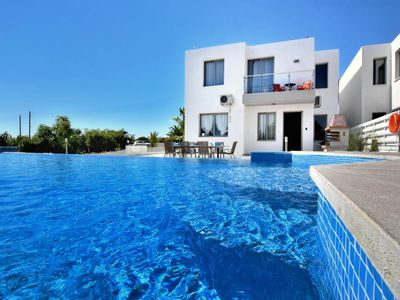 Photo for Villa Akama 2 - Modern family villa in Coral Bay with great terrace area - 4 bedrooms