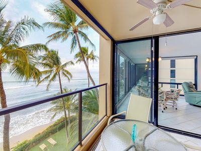 Photo for Stunning beachfront condo w/private lanai, sea views, shared hot tub, and pool