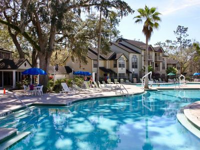 Photo for DISNEY GETAWAY! COMFY 1BR SUITE, 3 POOLS, HOT TUB, TENNIS COURTS, SHUTTLE