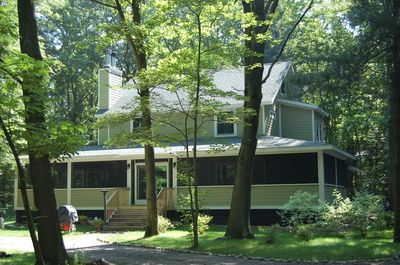 Huge screened in wrap-around porch for plenty of family fun!