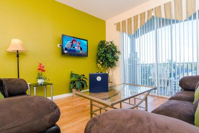 Professionally decorated stylish living area with 37-Inch wall mounted LCD TV