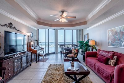 Living room with great views, sleeper sofa, large HDTV, and a piano!!