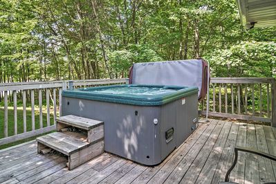 Savor the natural setting while taking a soak in your private hot tub.