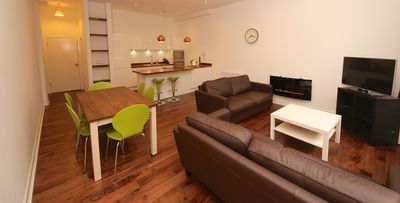 Open plan lounge, dining and kitchen. A superb space for relaxing in.