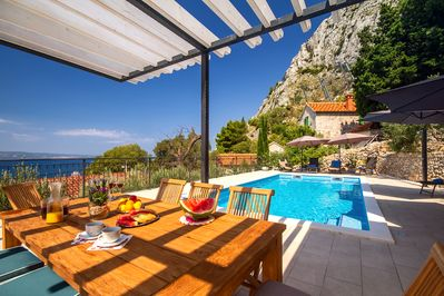 Open sea views from pool area, town Omiš and beautiful mountain environment