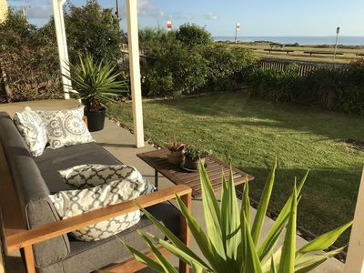 Photo for Exceptionally clean three bedroom beach house with uninterrupted bay views!